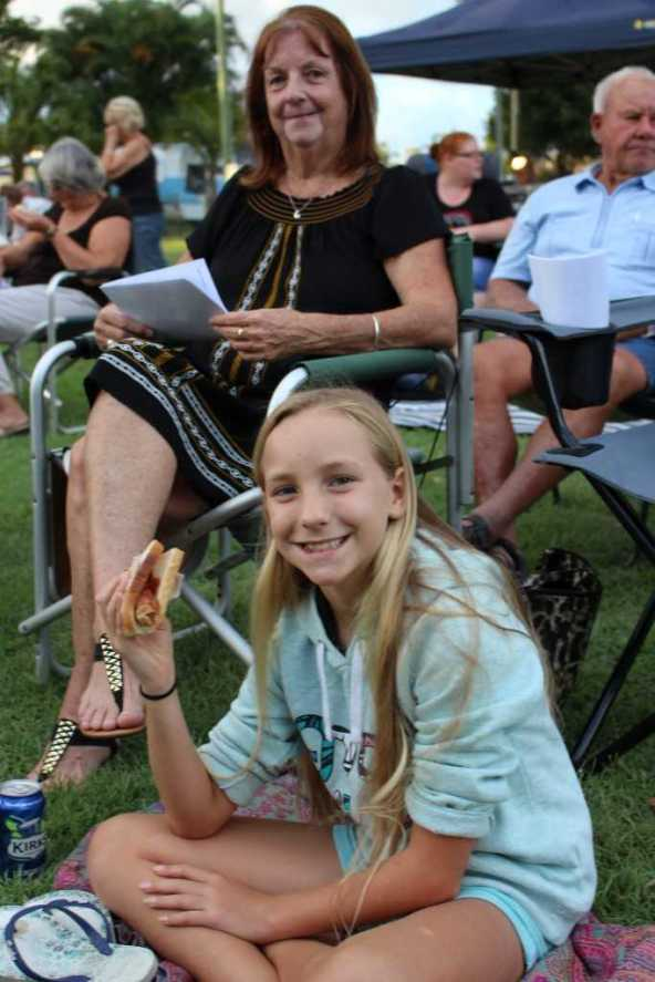 Indianna Sinclair enjoys a sausage while Nana Laurelle Levy waits for the carols to start - Image Jess Milne